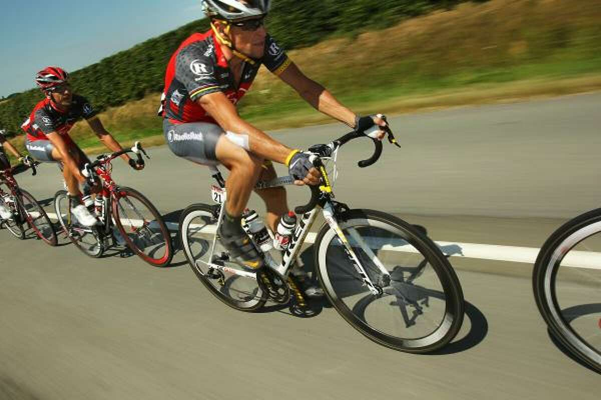 Lance Armstrong rides with the pack.