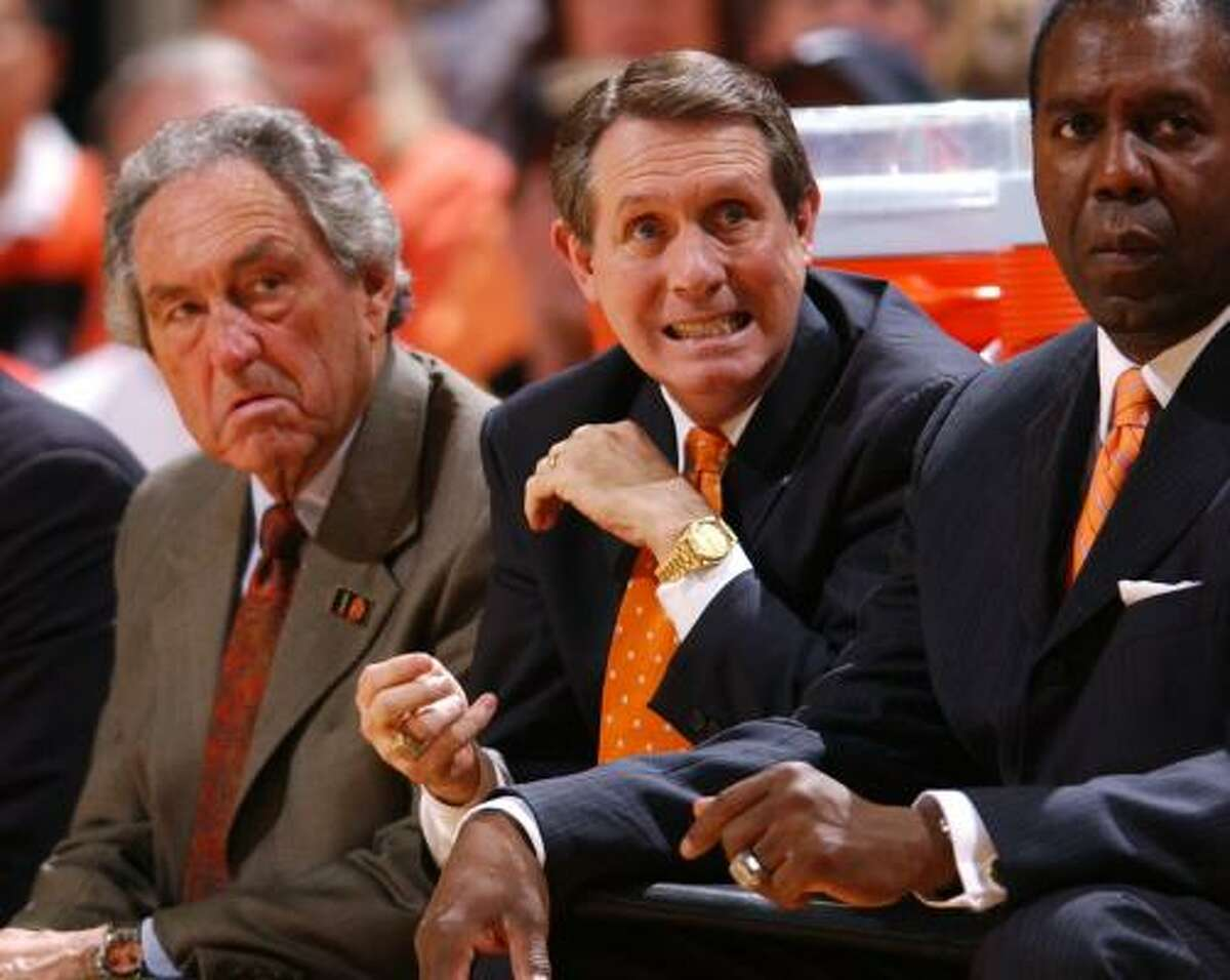 James Dickey, center, was an assistant coach at Oklahoma State for Eddie Sutton, left, for most of his tenure.