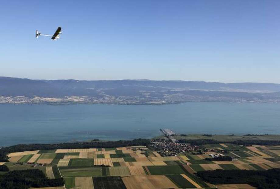 An experimental solar-powered plane completed its first 24-hour test flight successfully Thursday, proving that the aircraft can collect enough energy from the sun during the day to stay aloft all night. Photo: Denis Bailibouse, AP