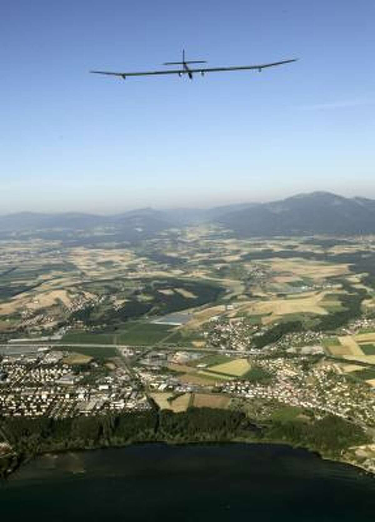 Pilot Andre Borschberg eased the Solar Impulse out of the clear blue morning sky onto the runway at Payerne airfield about 30 miles (50 kilometers) southwest of the Swiss capital Bern at exactly 9 a.m. (0700 GMT; 3 a.m. EDT).
