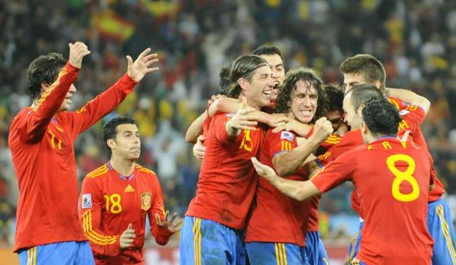 Spain players celebrate the nation's first trip to the World Cup final. Photo: PIERRE-PHILIPPE MARCOU, AFP/Getty Images