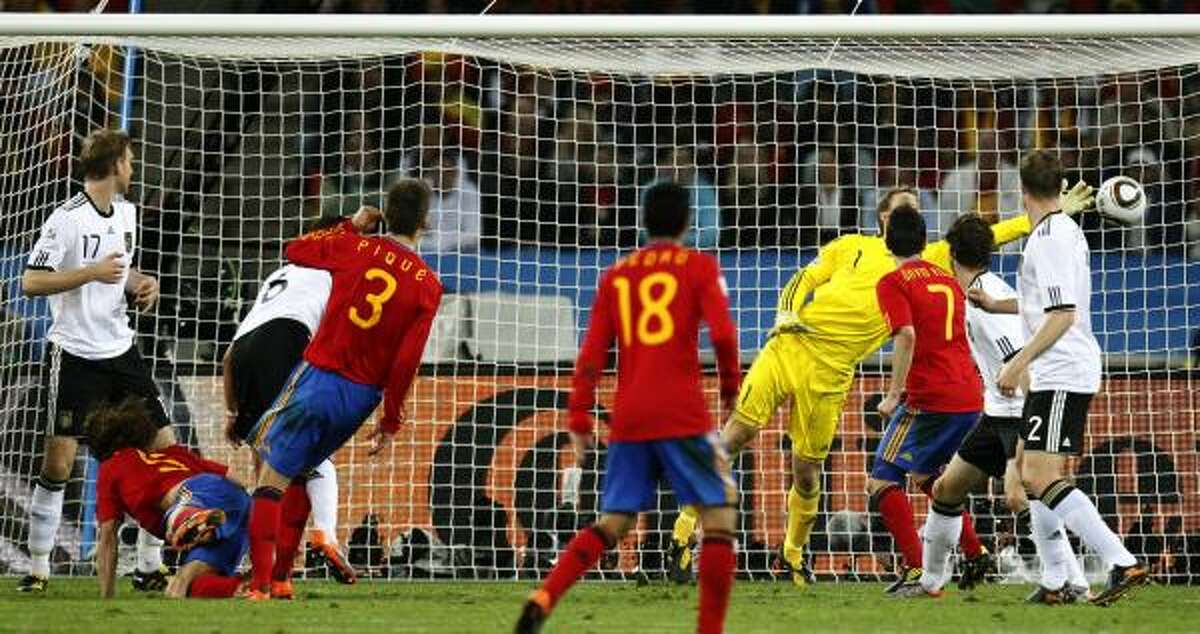 Spain's Carles Puyol, second from left in front, scores the winning goal past Germany goalkeeper Manuel Neuer in the 73rd minute.