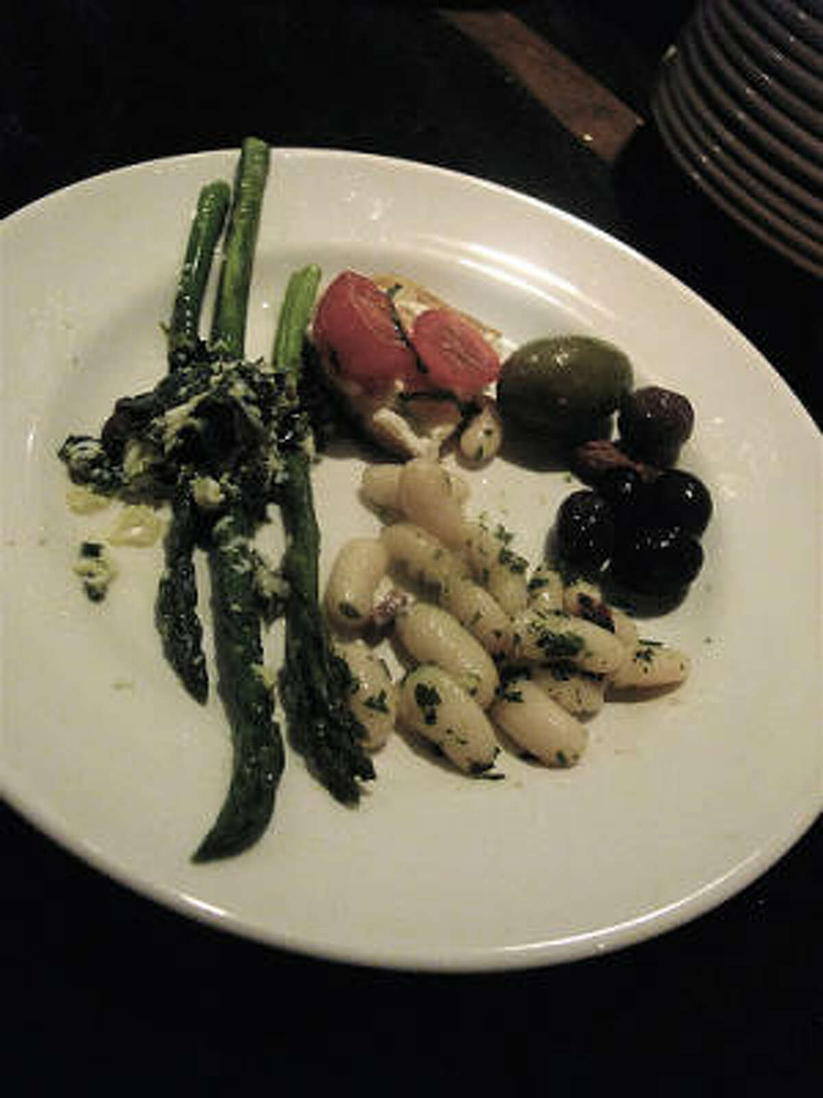 Antipasti at Tre Trattr=oria In San Antonio: asparagus with salsa rustica; bruschetta with house-made ricotta an cherry tomatoes; olives with fennel seed & orange; cannellini wih gremolata.
