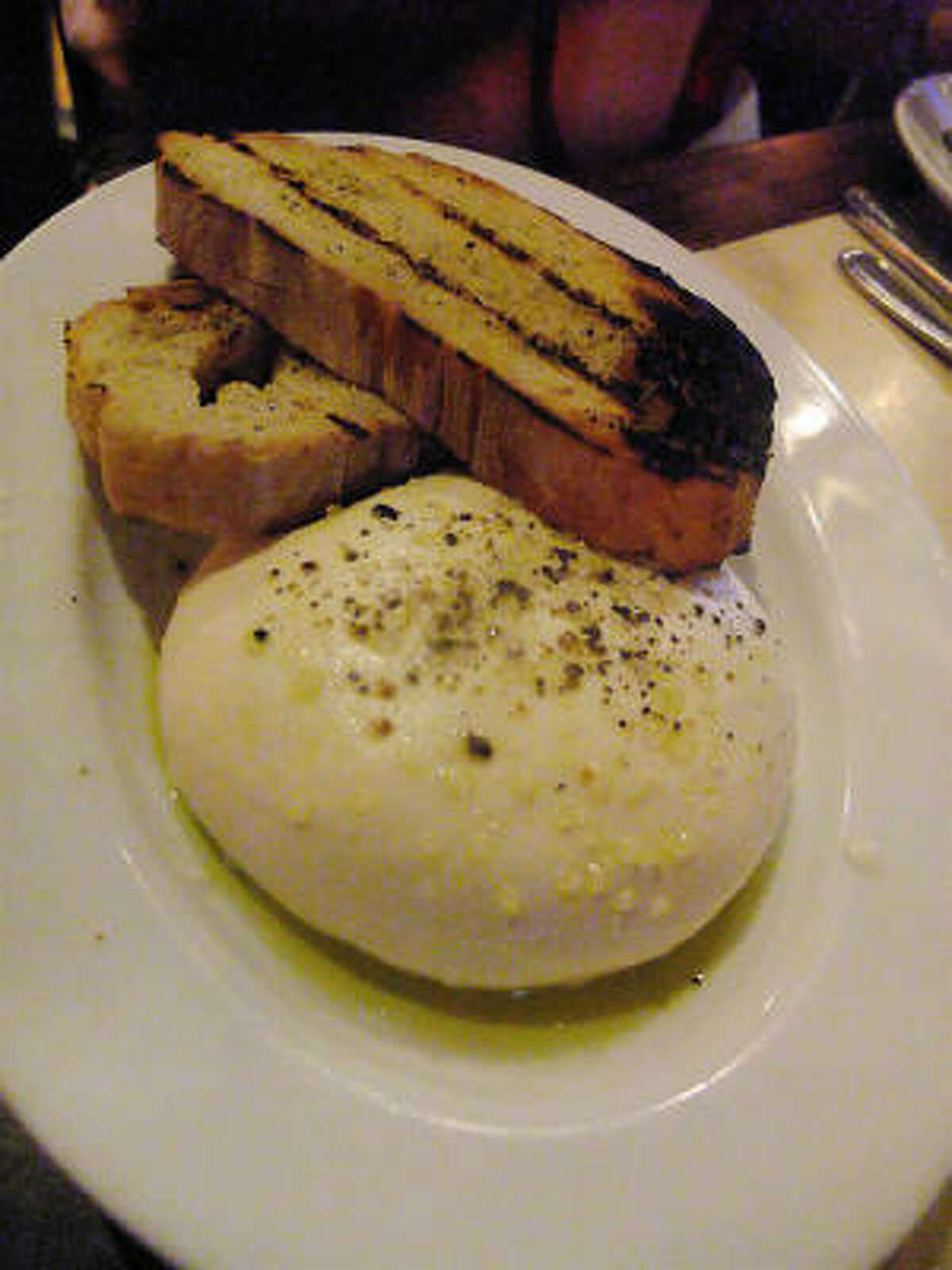 Pulled to order mozzarella with sea salt & charred Pugliese bread, Tre Trattoria in San Antonio.