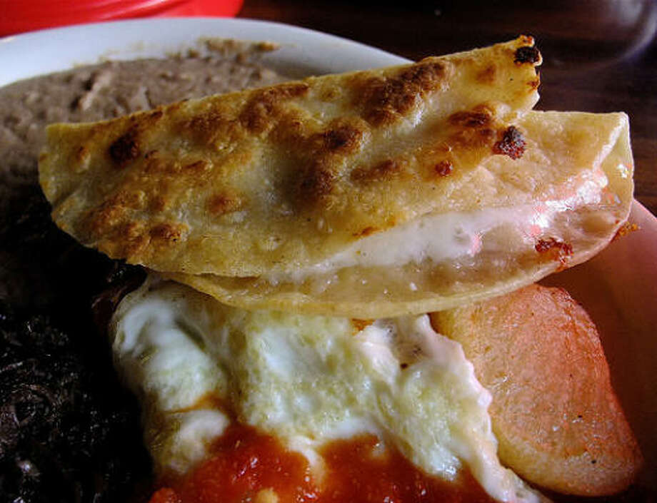 PHOTOS: Tex-Mex vs. Mexican foodSimple cheese quesadillas are a major part of a balanced Texas diet.Click through to learn more about the differences between Tex-Mex and Mexican food... Photo: Alison Cook, Chronicle
