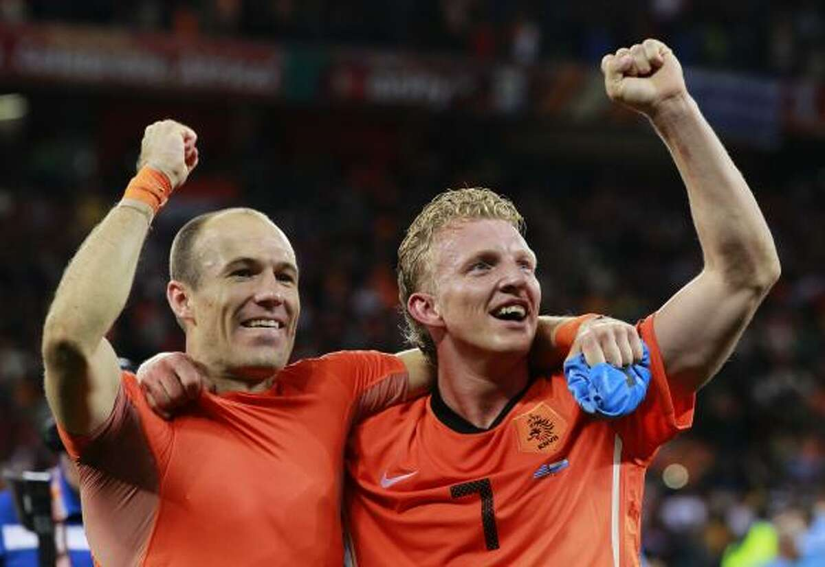 The Netherlands' Arjen Robben, left, and Dirk Kuyt celebrate following their tight win against Uruguay.