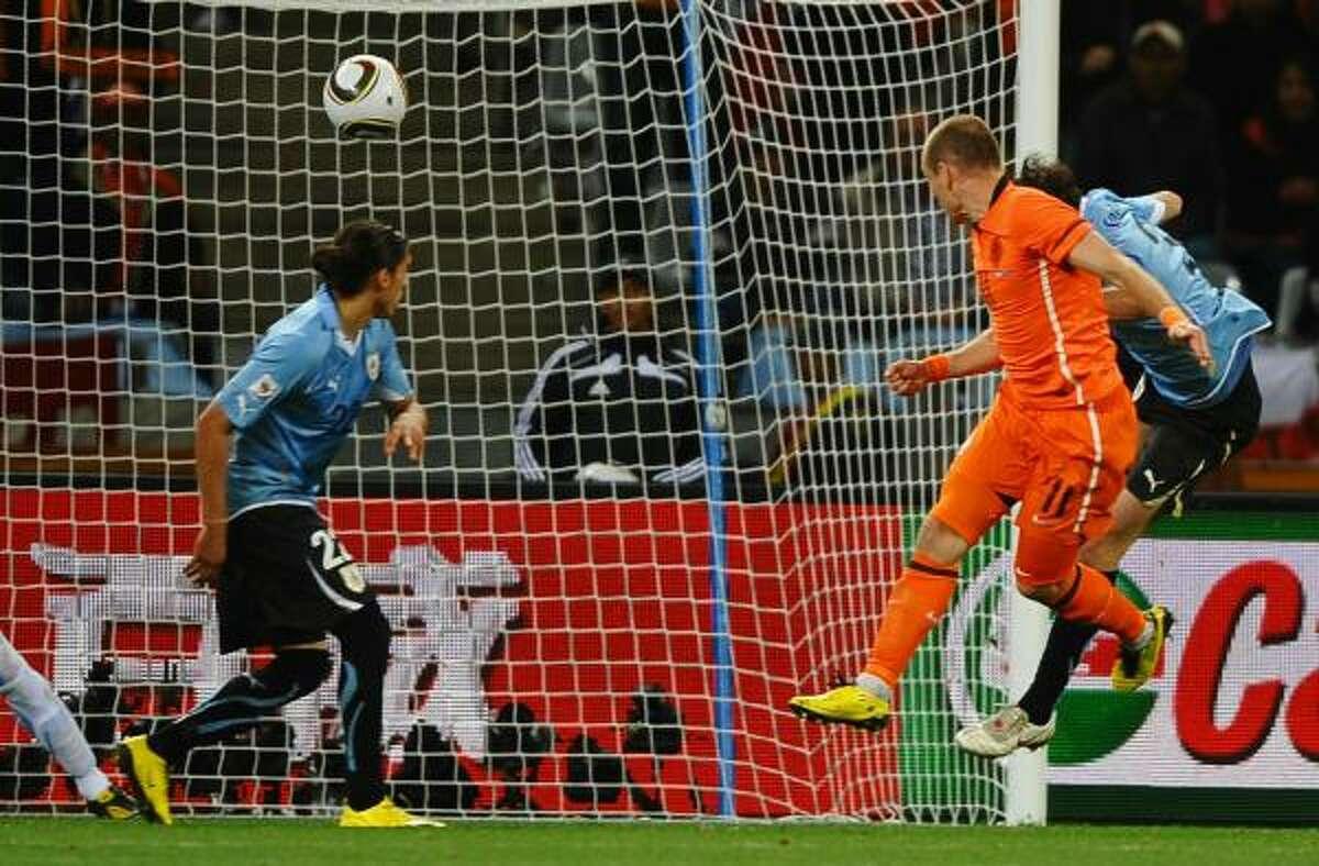 Arjen Robben of the Netherlands scores his team's third goal on a stellar header.