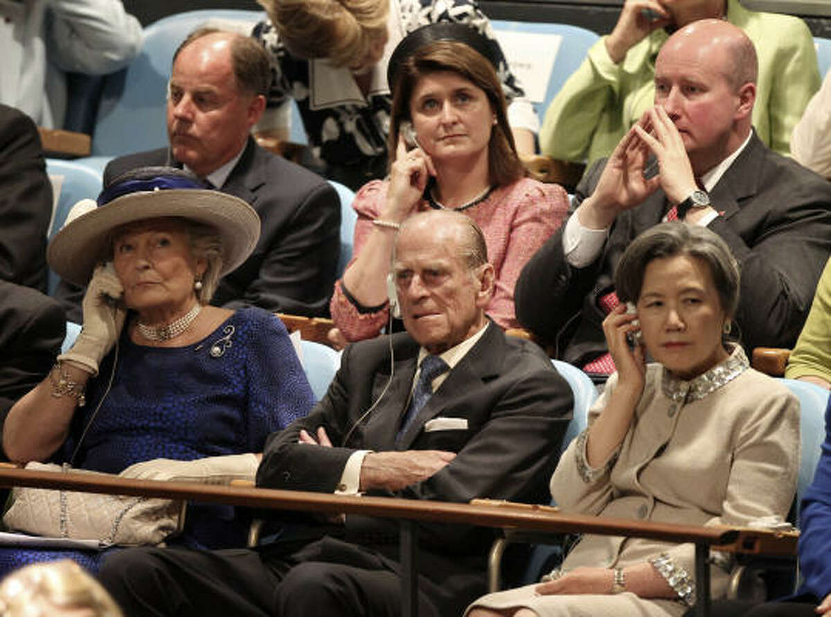 Prince Philip, center, listens to a speech by Queen Elizabeth II at United Nations Headquarters, Tuesday, July 6, 2010.
