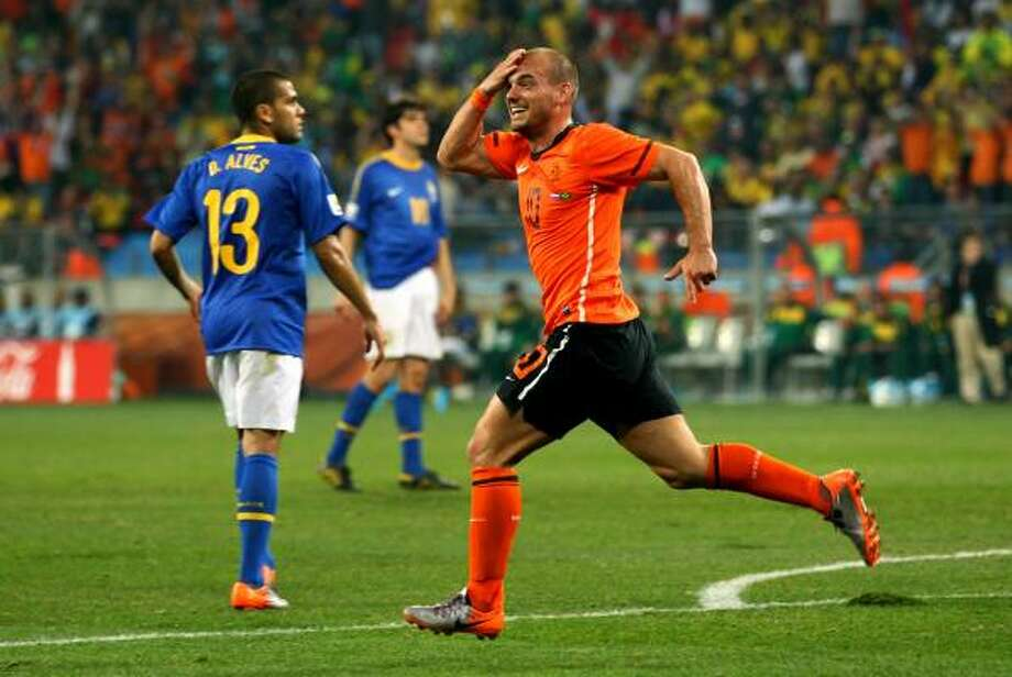 NETHERLANDS 2, BRAZIL 1 Wesley Sneijder of the Netherlands celebrates scoring his team's second goal at Nelson Mandela Bay Stadium in Port Elizabeth. Photo: Richard Heathcote, Getty Images