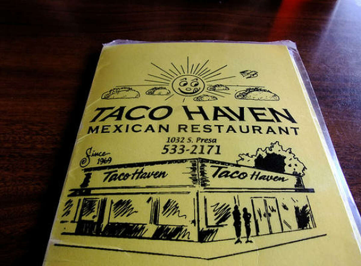 The laminated menu at Taco Haven in San Antonio features Mr. Sun licking his chops above a cloudscape of floating tacos.