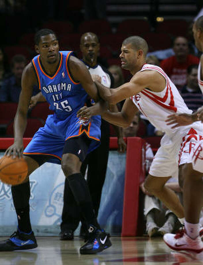 Shane Battier, right, played Thunder star Kevin Durant to a standstill with 18 points each. Photo: Mayra Beltran, Chronicle