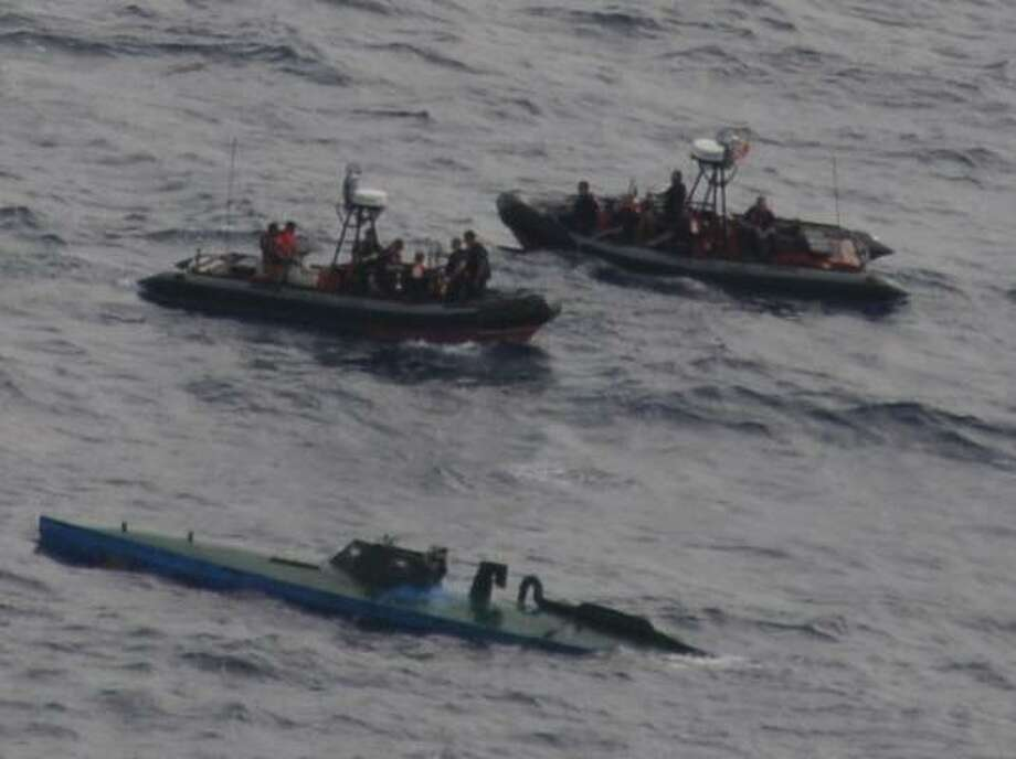 "A U.S. Coast Guard cutter, guided by aircraft from Customs and Border Protection, captured this so-called ""narco sub"" - packed with cocaine - off the coast of Colombia in 2010. Photo: Coast Guard"