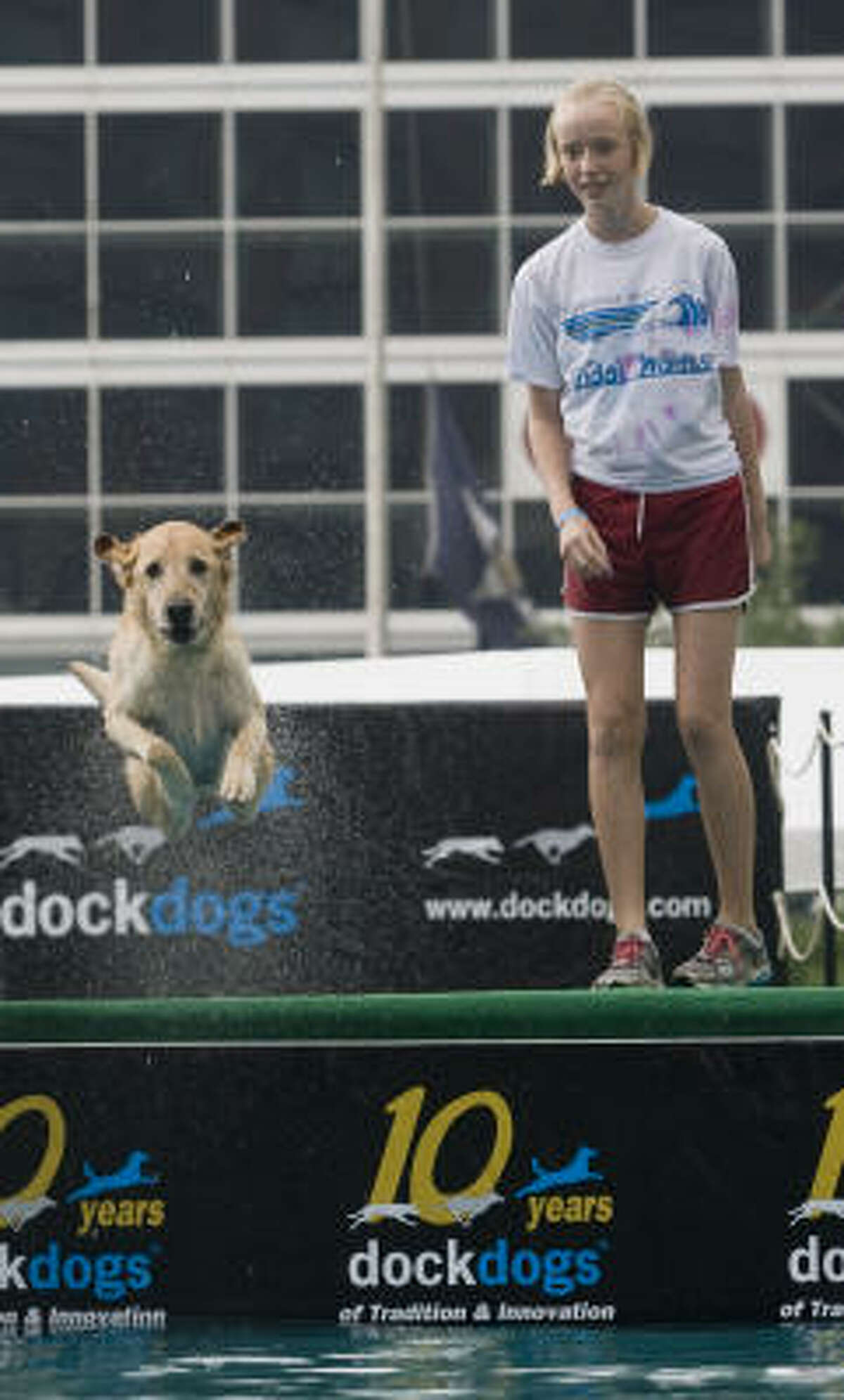 Jenny Sheeren watches as her dog, Sammy, races off the dock at the DockDogs event at Discovery Green Friday.