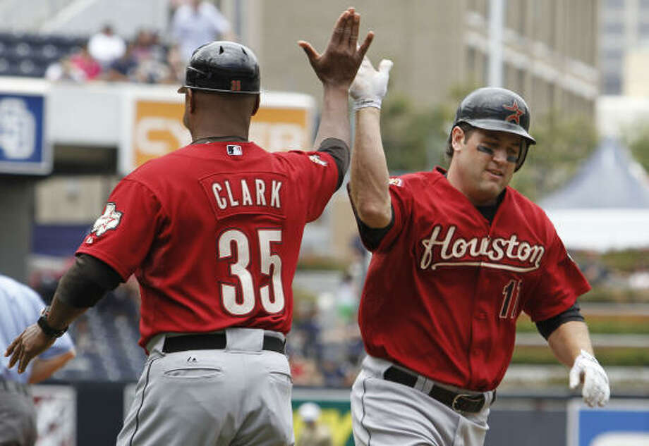 July 4: Padres 3, Astros 2 Astros first baseman Lance Berkman high fives third base coach Dave Clark as he rounds third after a solo home run in the first inning. Photo: Denis Poroy, AP