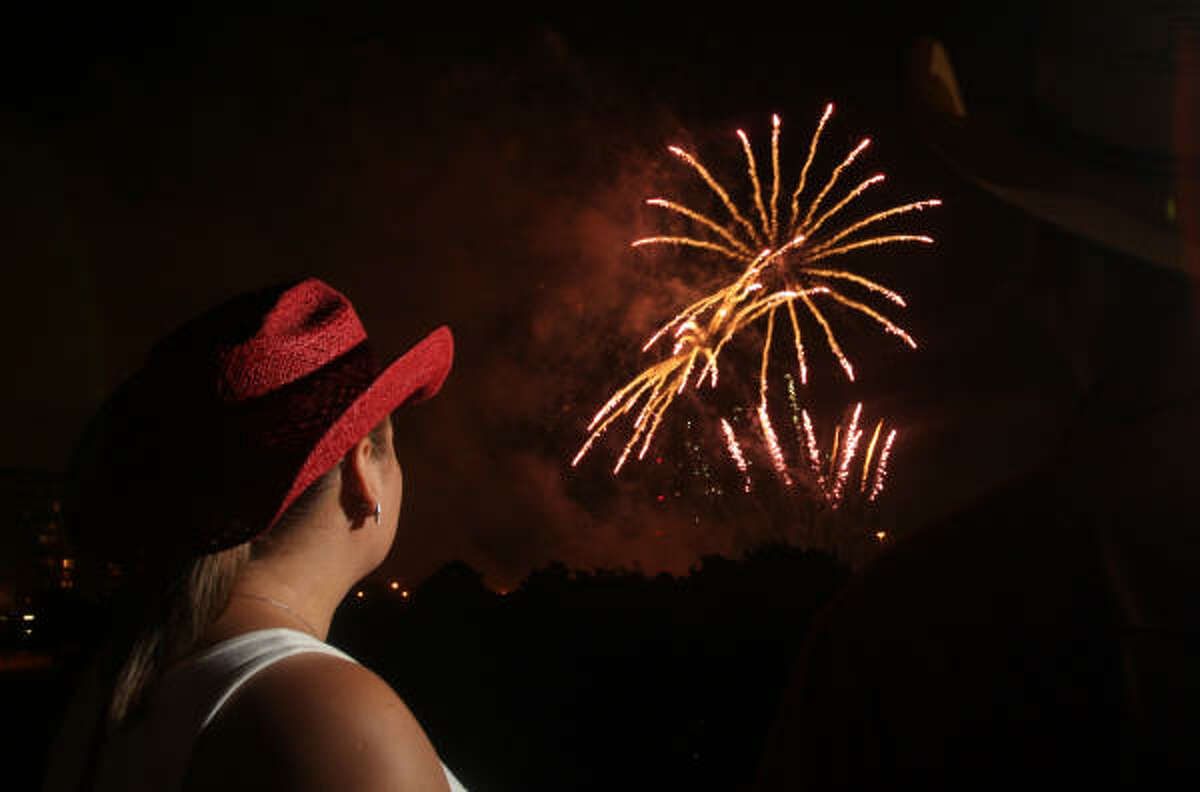 Irma Garcia admires the fireworks at the Freedom Over Texas bash held at Eleanor Tinsley Park.