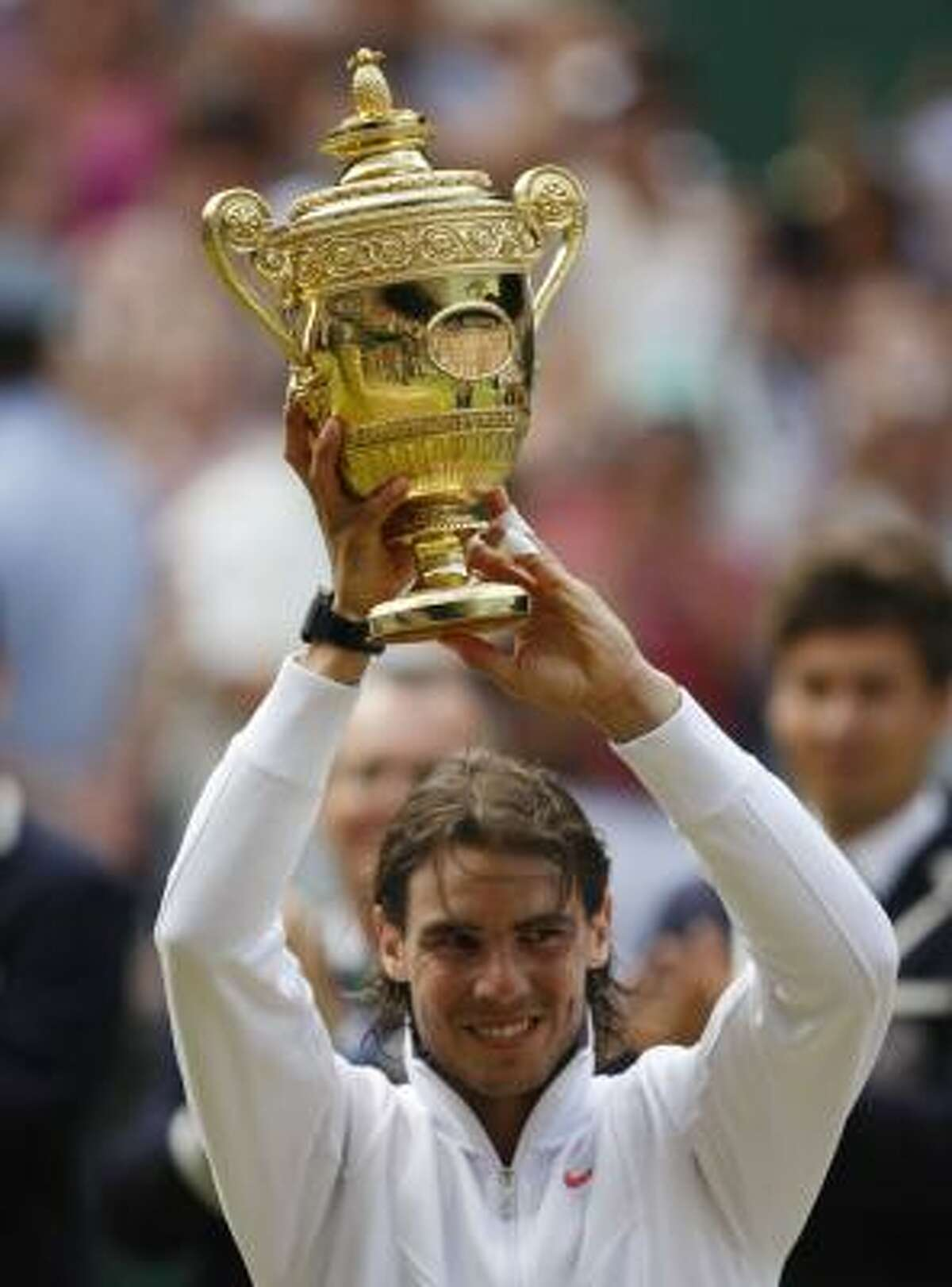 Rafael Nadal shows off his trophy.