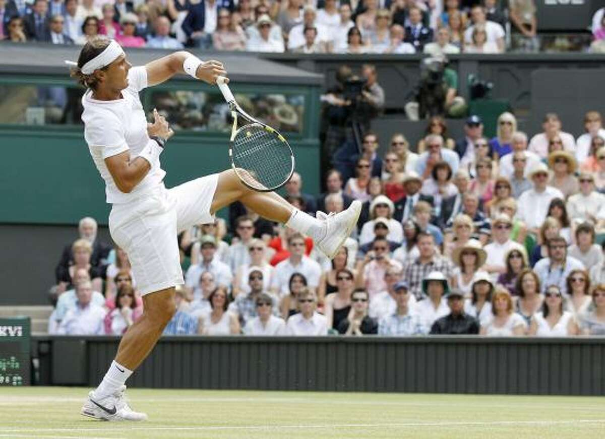 Rafael Nadal makes a overhead return to Tomas Berdych.