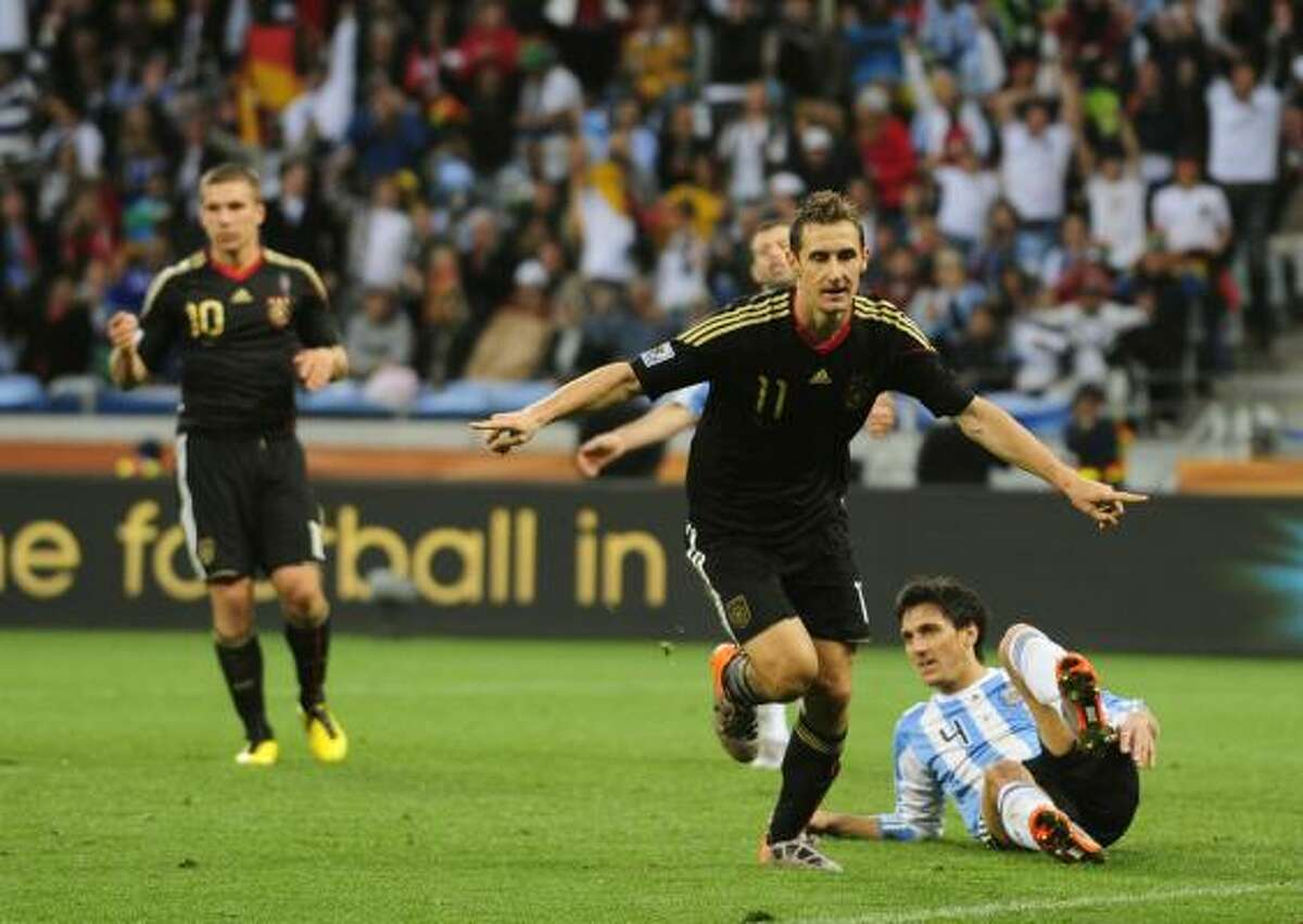GERMANY 4, ARGENTINA 0 Germany striker Miroslav Klose, front, scored twice to lead his team to an impressive win over Argentina.