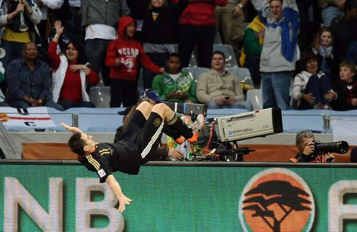 Germany's Miroslav Klose does a flip after scoring one of his two goals.