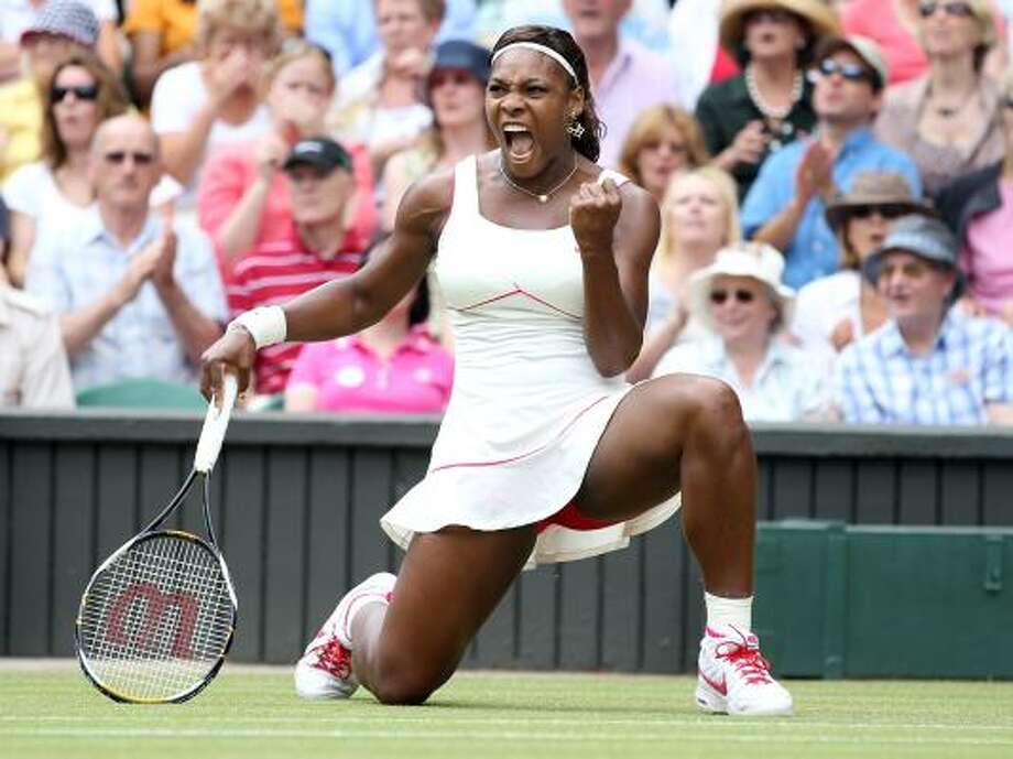 July 3  Serena Williams captured her fourth title at Wimbledon and 13th Grand Slam championship with a 6-3, 6-2 victory over 21st-seeded Russian Vera Zvonareva. Photo: Alastair Grant, AP