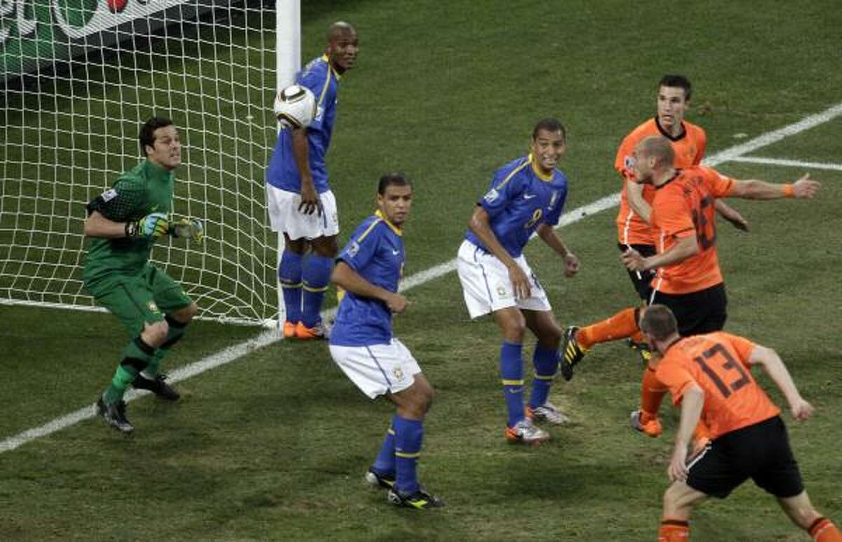 Netherlands' Wesley Sneijder, second right, scores the team's second goal.