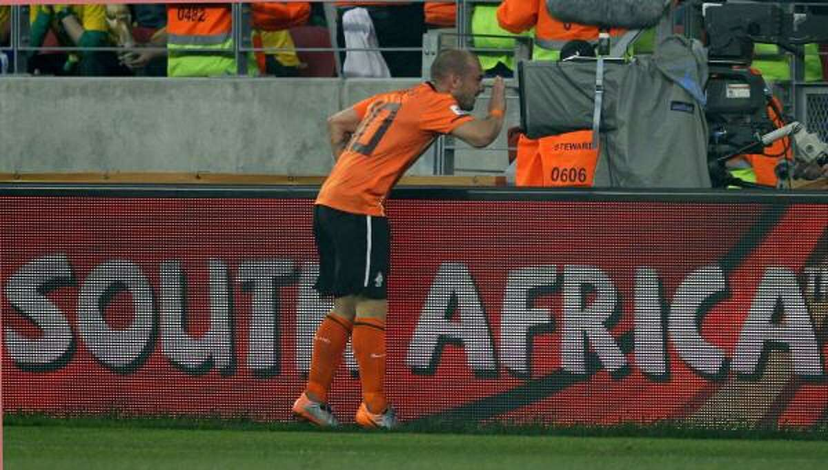 Netherlands' Wesley Sneijder jokes with a cameraman after Brazil's Felipe Melo, not visible, scored an own goal.