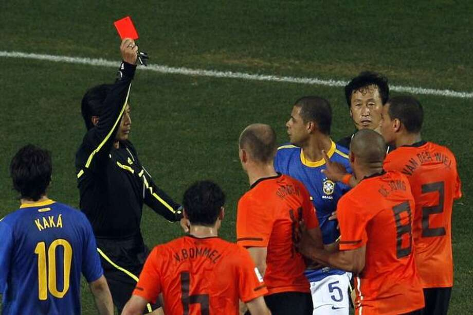 When things get downright dirty on the soccer pitch, sometimes the referees have to bring out the big guns. See some of the notable red card moments in FIFA World Cups past. Photo: Roberto Candia, AP