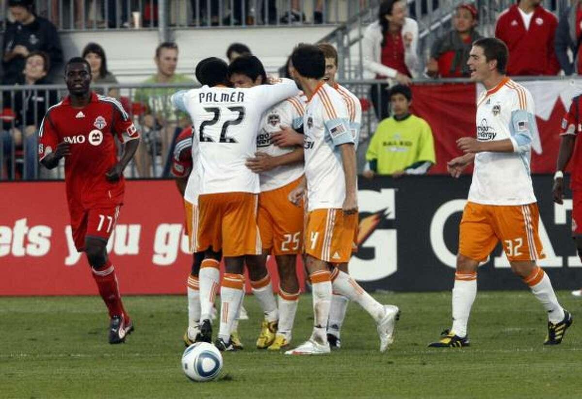 Dynamo celebrates Brian Ching's goal against Toronto FC.