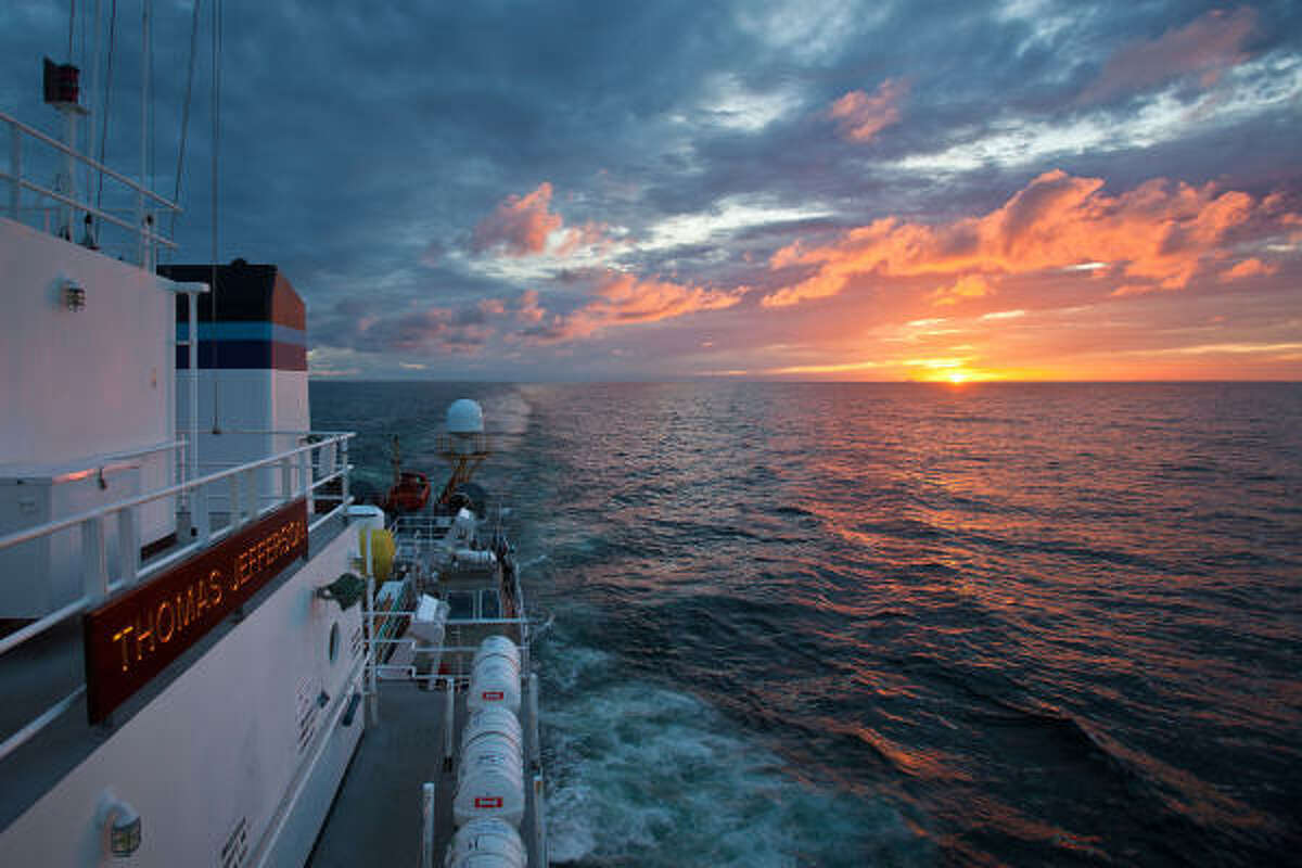 The sun sets over the Alabama coast as seen from aboard the NOAA Ship Thomas Jefferson in the Gulf of Mexico. The ship is looking for signs of oil spreading underwater from the Deepwater Horizon oil leak.