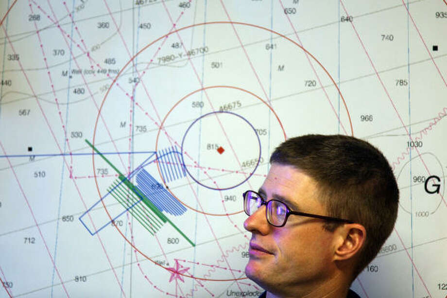 Lt. Sam Greenaway is seen in front of a plot of the Deepwater Horizon site and the ship's route while reviewing data collected aboard the NOAA Ship Thomas Jefferson. Photo: Smiley N. Pool, Chronicle