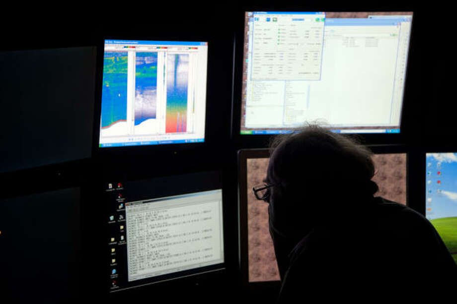Peter Lewit studies sonar screens aboard the NOAA Ship Thomas Jefferson. Photo: Smiley N. Pool, Chronicle