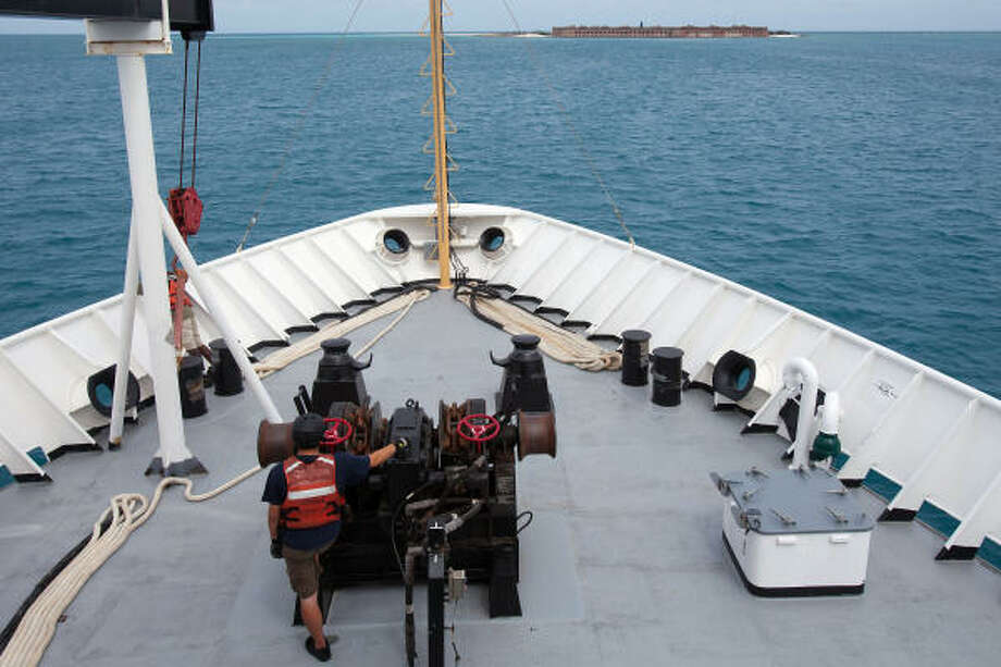 Crew members aboard the NOAA Ship Thomas Jefferson prepare to drop anchor near the Dry Tortugas in the Gulf of Mexico off the coast of Florida. Photo: Smiley N. Pool, Chronicle