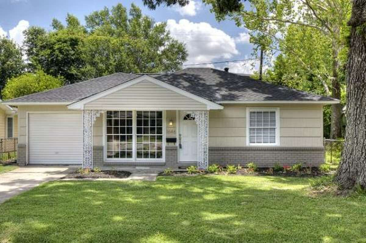 This three-bedroom home has refinished hardwood in the living room and dining room, updated ceramic tile in the kitchen and granite counters. It's listed for $199,900. See more details and photos here.