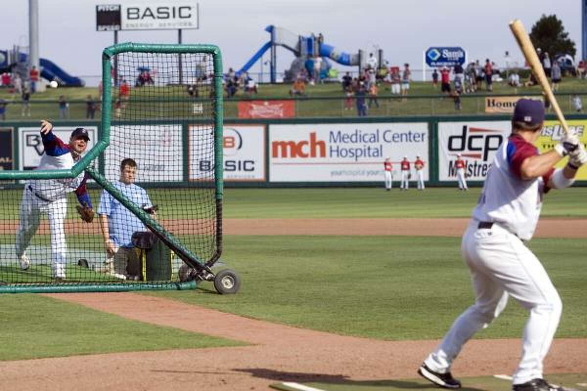 Former major league pitcher Roger Clemens pitches to his son, Koby, during Wednesday's home-run derby Texas League All-Star Game. Koby later went hitless in four at-bats during the game.
