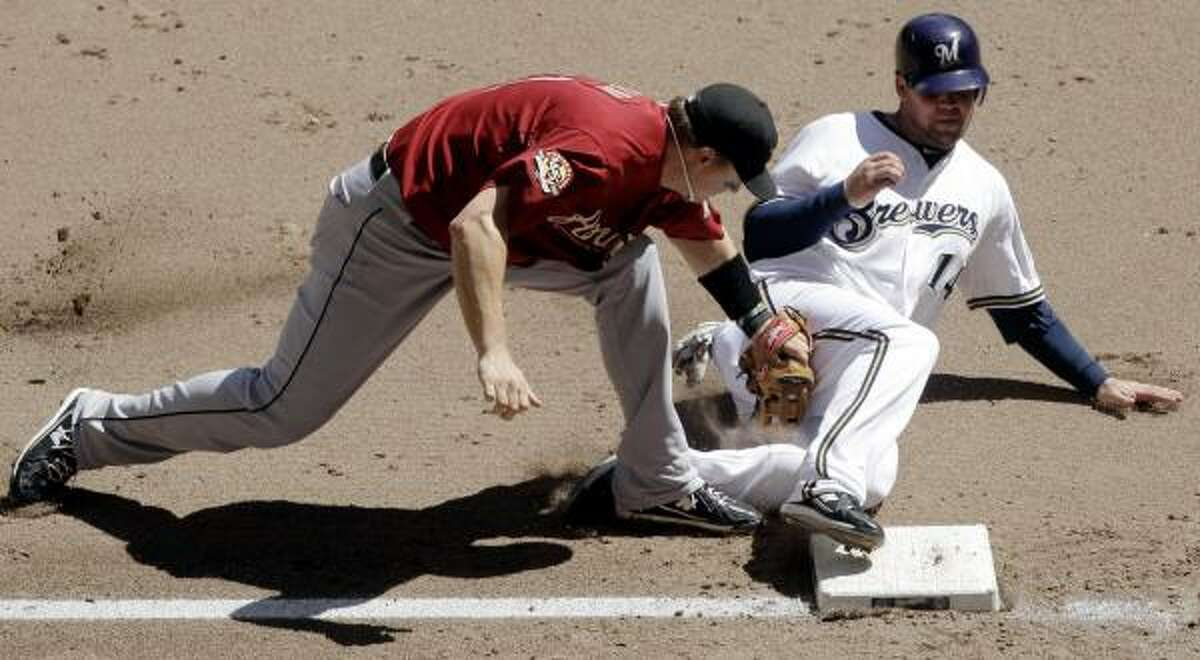 Astros third baseman Chris Johnson tags out Brewers' Casey McGehee at third during the sixth inning.