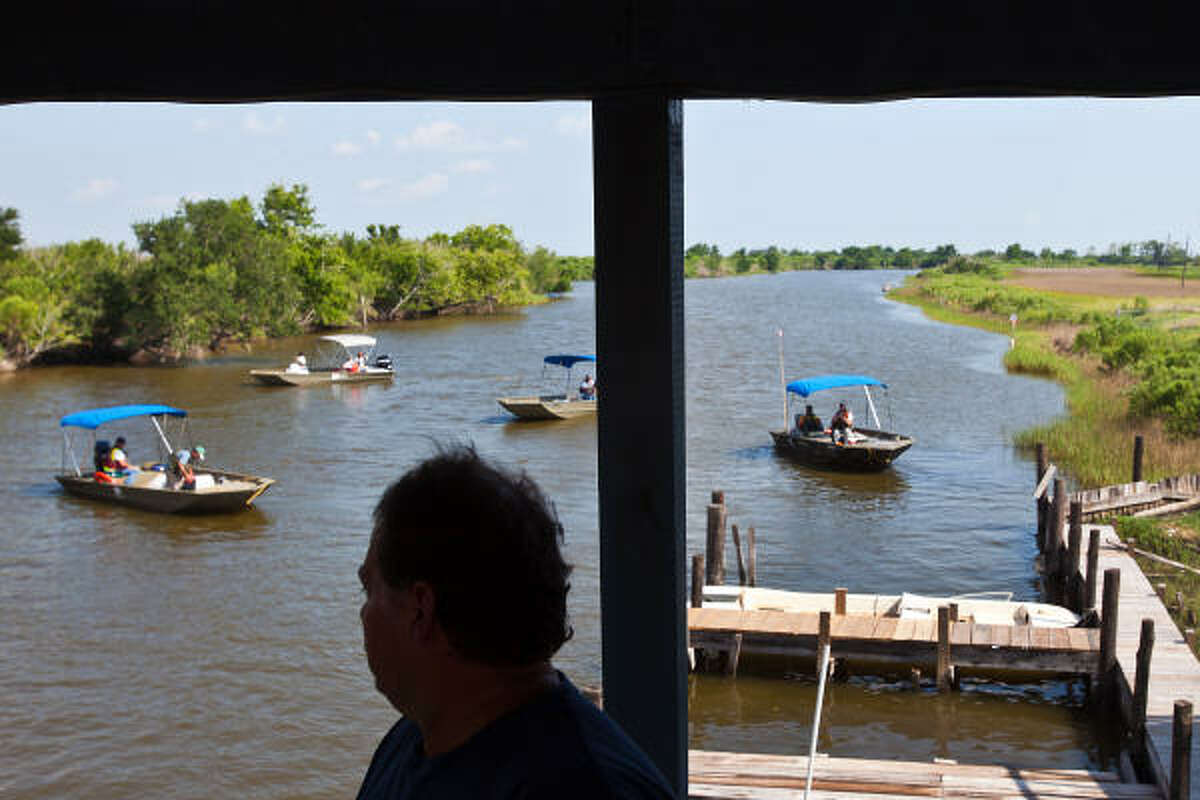Dale Chaisson watches as boats contracted by BP pull into the docks at Isle de Jean Charles Marina in Pointe Aux Chenes, La. The marina is run by his cousin Theo Chaisson and has been idle since the Deepwater Horizon spill, except for the occasional group for BP contractors who come by for a snack or soda. Dale Chaisson is an oysterman with four boats, all idle, who is hoping to at least get work as a vessle of opportunity.