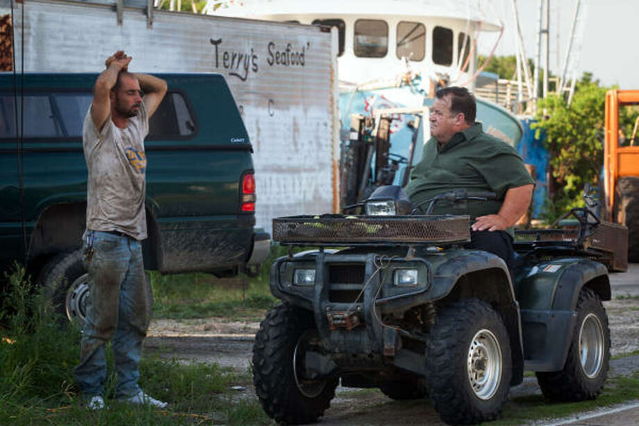 Fisherman Terry Nettleton, right, talks with an empoyee as his boats sit idle in Montegut, La.  Nettleton says his boats have been passed over for the vessels of opportunity program and he hasn't had work for his nearly 100 employees since the Deepwater Horizon spill. Photo: Smiley N. Pool, Chronicle
