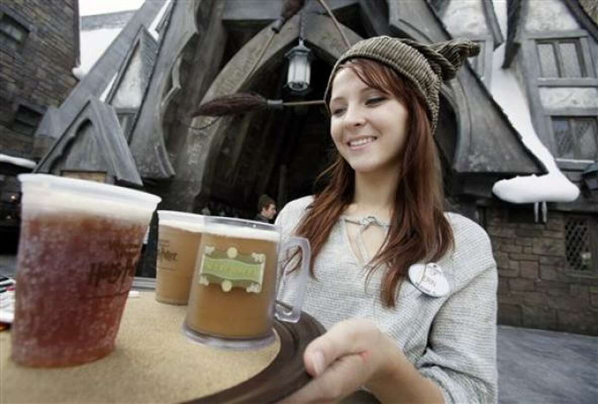Erin Wuchte serves up Butterbeer to guests.
