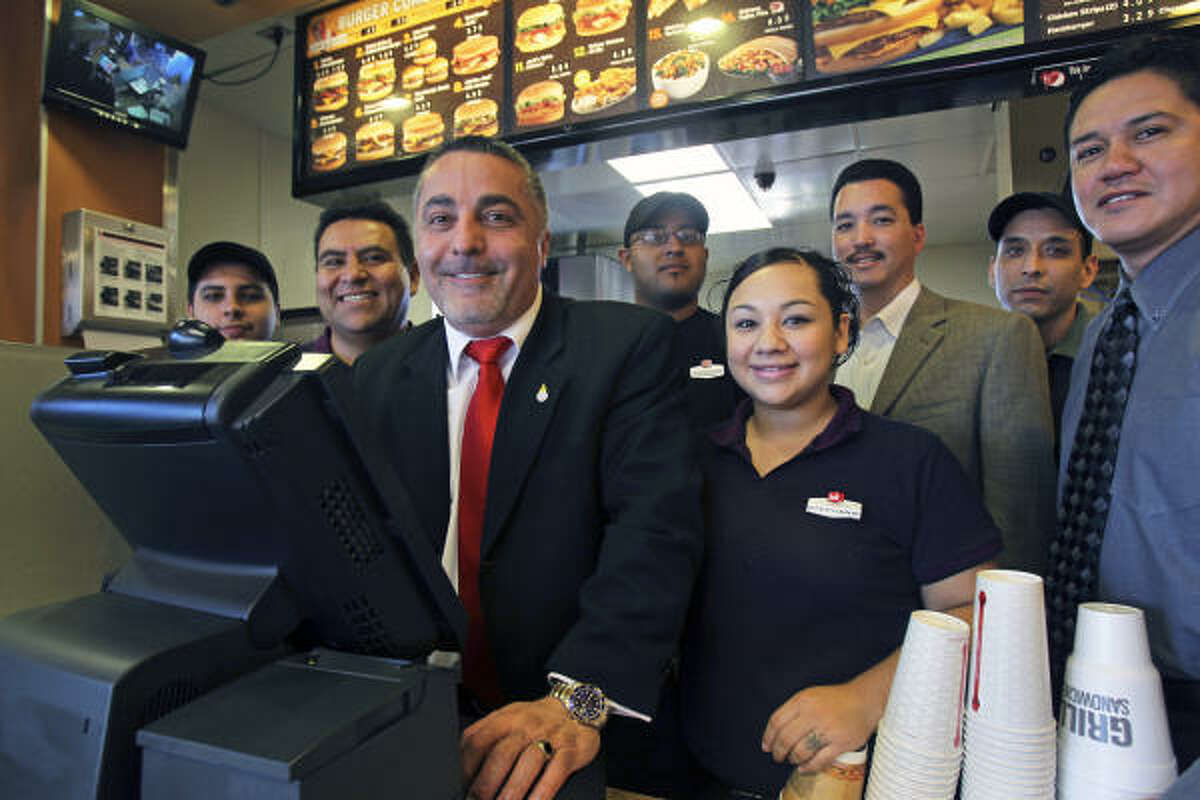 Atour Eyvazian, with the crew at a Jack in the Box in San Antonio, says he is humbled by the praise he receives for his success.