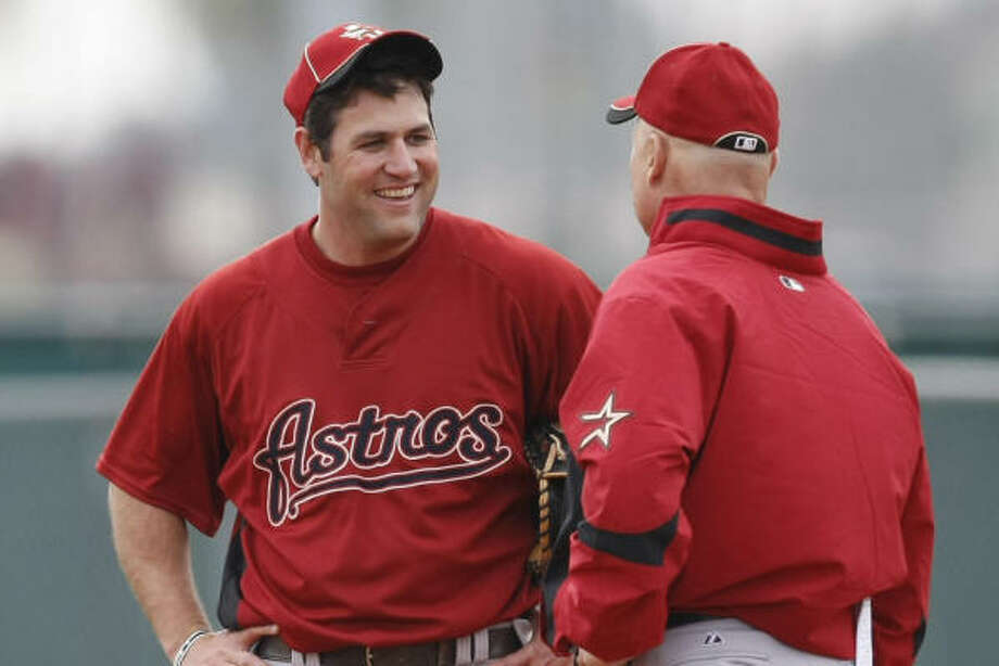 Lance Berkman, left, suffered his contusion just days into spring training before his 12th year as an Astro. Photo: Julio Cortez, Chronicle