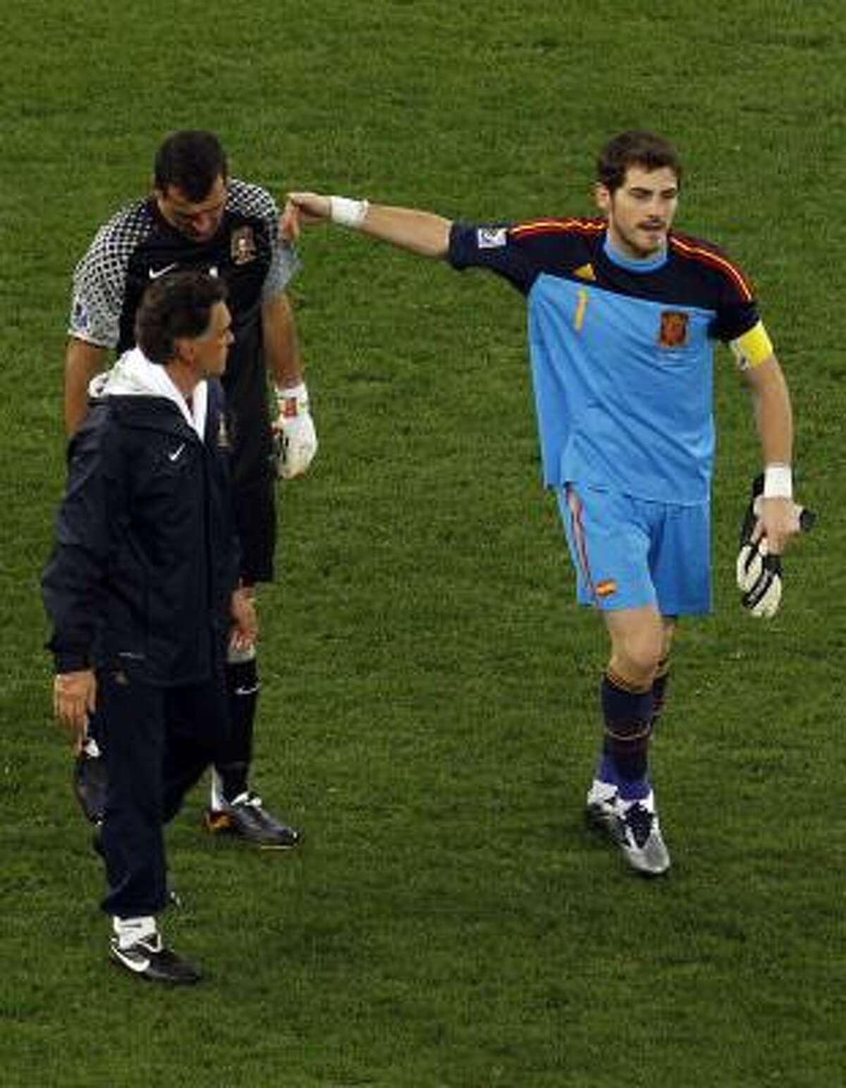 Spain goalkeeper Iker Casillas, right, consoles Portugal goalkeeper Eduardo after the match.