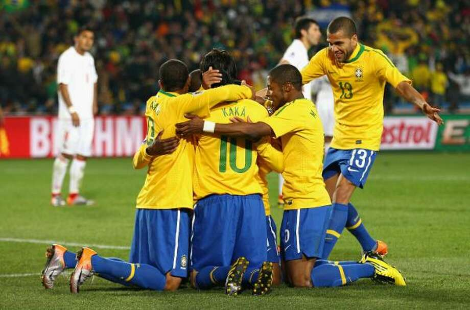 BRAZIL 3, CHILE 0Brazil players celebrate Robinho's 59th minute goal. After a slow start, the five-time champions steamrolled their South American counterparts at Ellis Park Stadium in Johannesburg. Photo: Richard Heathcote, Getty Images