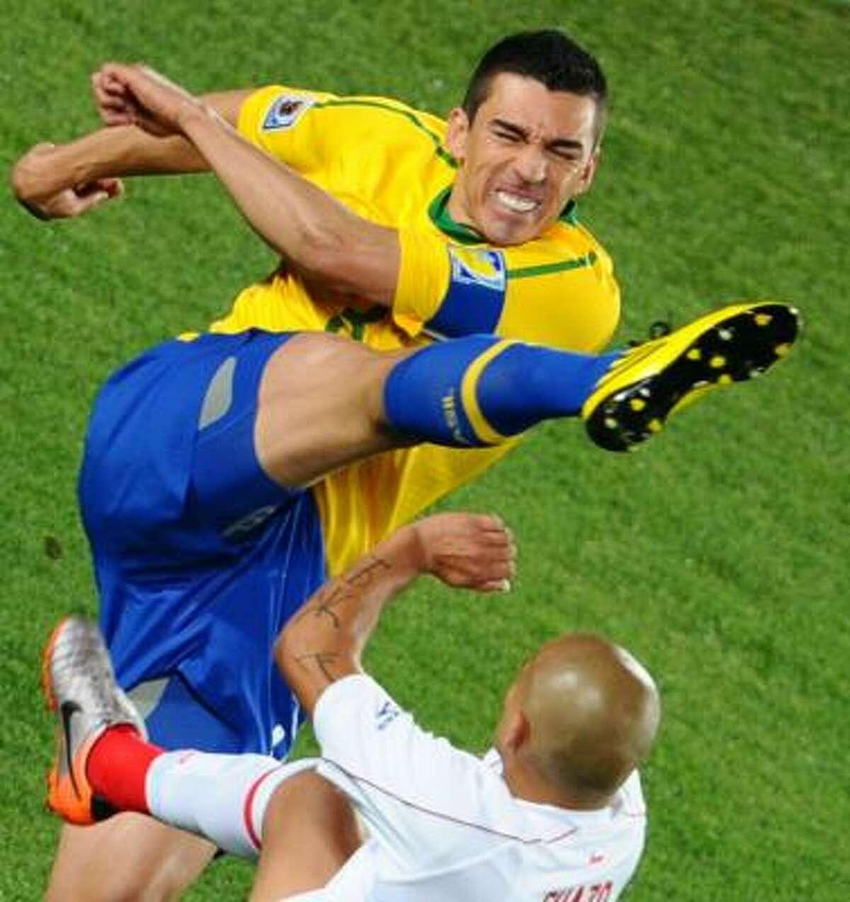 Brazil defender Lucio clears the ball from Chile striker Humberto Suazo.