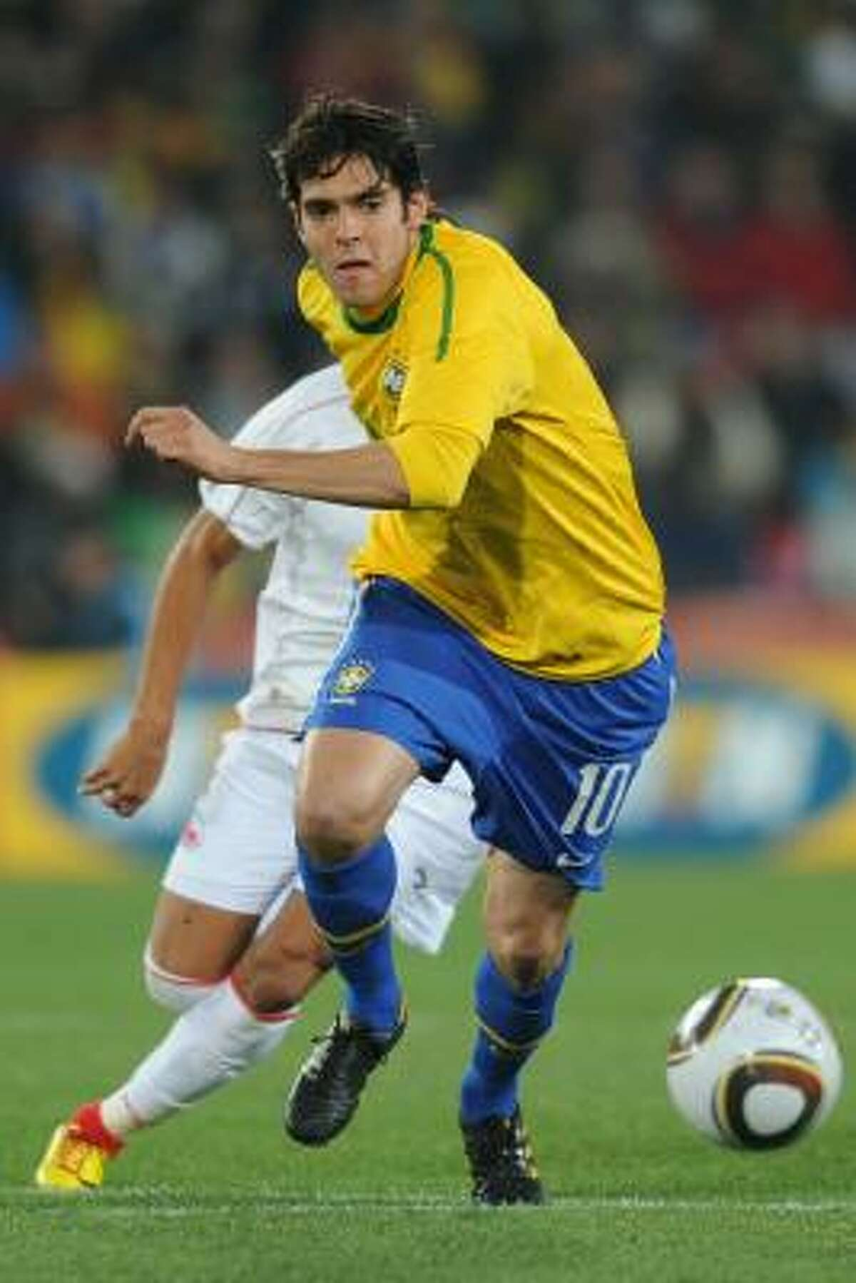 Brazil midfielder Kaká makes a run against Chile.