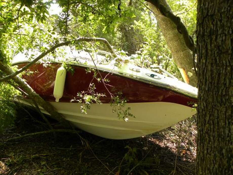 A 48-year-old woman died when this boat crashed along Clear Creek, according to Leage City police. Photo: League City PD