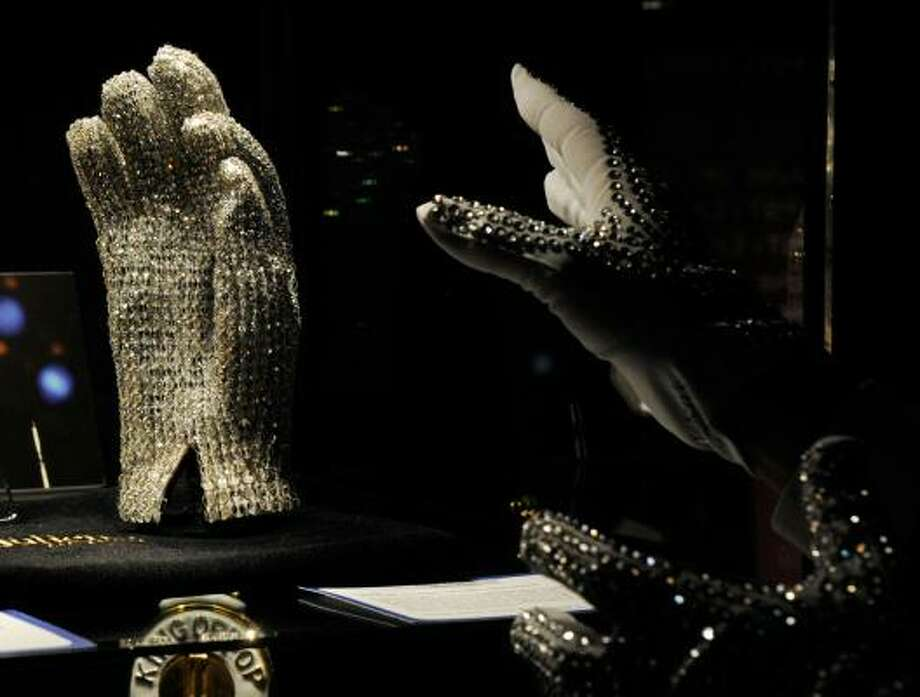 Who's Bad?:Michael Jackson Victory Tour glove, covered in clear Swarovski crystals, not only went to the highest bidder at $192, 000, it received a standing ovation when sold. Photo: Ethan Miller, Getty Images
