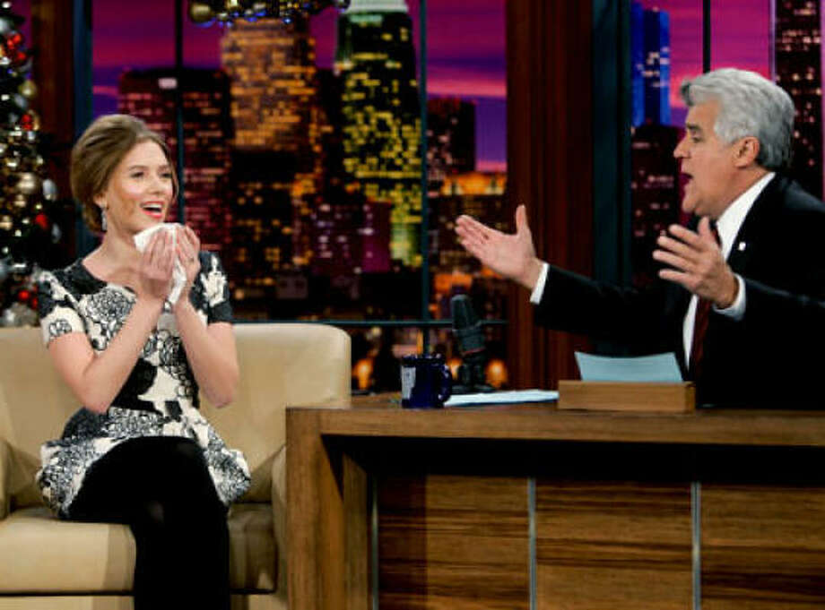 Scarlett Johannson once made $5,300 just for blowing her nose, after a tissue she used while appearing on the Jay Leno show in 2008 was sold on Ebay to benefit the hunger charity USA Harvest. Photo: NBC
