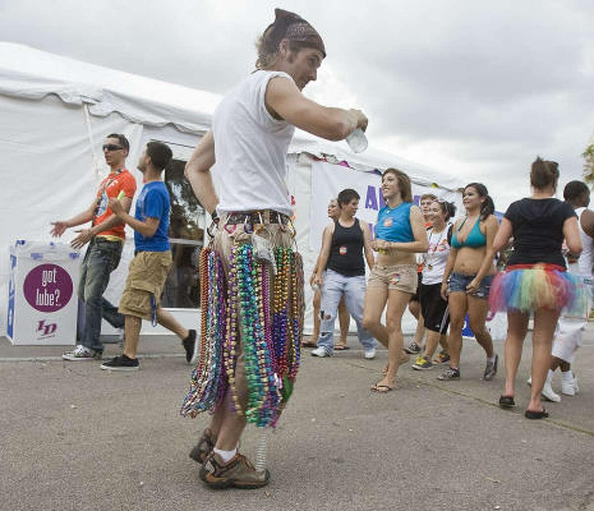 Owen McGouegle sells beads during the Pride Houston Festival.
