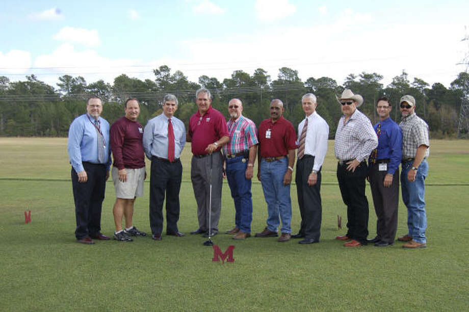 Magnolia ISD staff check out the newly completed facility that features a 12,000-square foot tee box. Photo: Special To The Chronicle