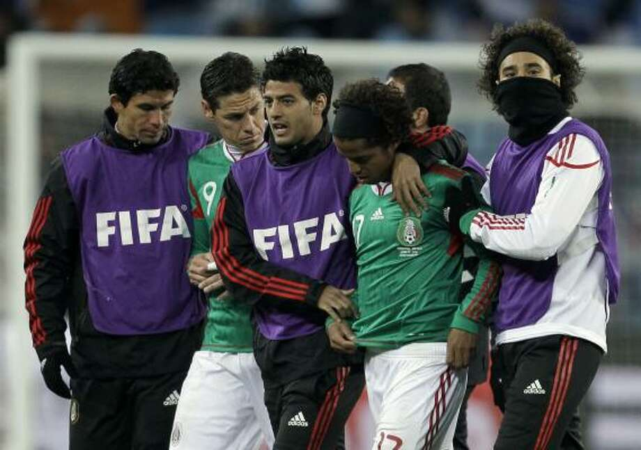 ARGENTINA 3, MEXICO 1Mexico players walk off in dejection after their team was eliminated in the second round of the World Cup at Soccer City Stadium in Johannesburg. Photo: Matt Dunham, AP